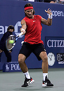 Carlos Moya of Spain hits a forehand return to James Blake of the US in their third round match on the seventh day of the 2006 US Open tennis tournament in Flushing Meadows New York Sunday 03 September 2006.