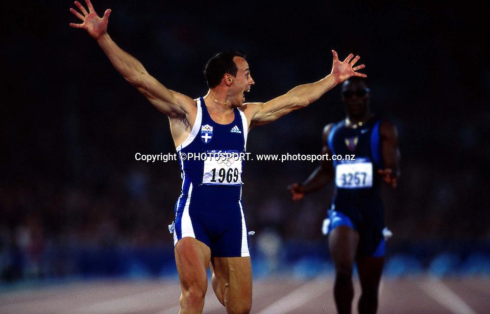 Konstantinos Kenteris of Greece celebrates after winning Mens 200m Final, at the Sydney Olympic Games on September 28 2000. Photo: PHOTOSPORT<br /><br /><br />atletics sprints sprinting sprint