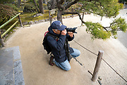 photographer making a picture at the Ginkakuji Silver Pavilion Zen Garden in Kyoto Japan