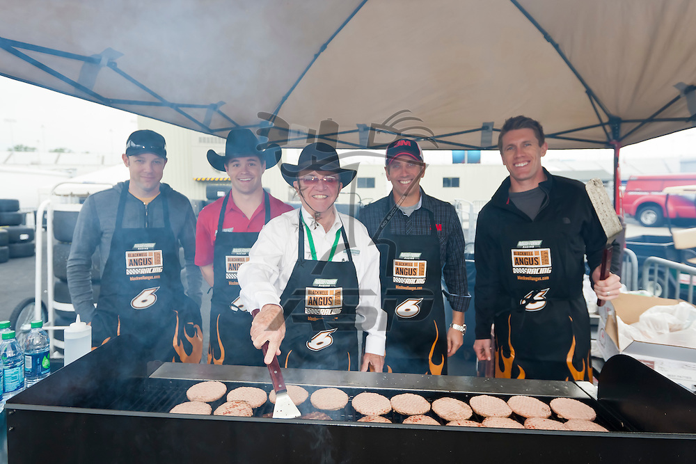 RICHMOND, VA - APR 28, 2012:  NASCAR team owner Jack Roush (center), and drivers, left to right, Matt Kenseth, Ricky Stenhouse Jr., Greg Biffle and Carl Edwards grill Cargill beef burgers at Richmond International Raceway, prior to the April 28 Sprint Cup race there.  Cargill is the sponsor of the Roush Fenway No. 6 Ford Mustang driven by Stenhouse in the NASCAR Nationwide Series.  Burgers containing finely textured beef were served to Air Force personnel, Stenhouse race fans and news media during the race weekend in Virginia, April 26-28, 2012.