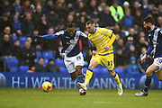 Birmingham City midfielder Jacques Maghoma (19) battles with Sheffield Wednesday defender Jack Hunt (32) during the Sky Bet Championship match between Birmingham City and Sheffield Wednesday at St Andrews, Birmingham, England on 6 February 2016. Photo by Jon Hobley.