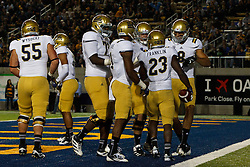 BERKELEY, CA - OCTOBER 06: Running back Johnathan Franklin #23 of the UCLA Bruins is congratulated by teammates after scoring a touchdown against the California Golden Bears during the third quarter at California Memorial Stadium on October 6, 2012 in Berkeley, California. The California Golden Bears defeated the UCLA Bruins 43-17. (Photo by Jason O. Watson/Getty Images) *** Local Caption *** Johnathan Franklin