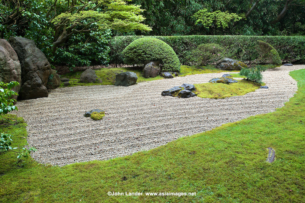 "The Zen Garden at the San Francisco Golden Gate Park Japanese Tea Garden was designed by Nago Sakurai, a leading Japanese landscape architect.  Dry landscape gardens, often called ""zen gardens"" were introduced into Japan originally from China during the Kamakura Period.  Japanese Zen monks, during studies in China, were impressed with landscape scrolls and rock work in Chinese gardens.  So when they returned to Japan they adapted them and created what we think of today as a ""zen garden"" or ""dry landscape garden"".  The sand, gravel, stones are meant ro symbolize mountains, hills, islands, rivers, oceans and ponds."