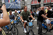 "UK, August 12 2012: Arnold Schwarzenegger on a Barclays ""Boris"" Bike in Piccadilly Circus on Sunday 12th August 2012. Copyright 2012 Peter Horrell."