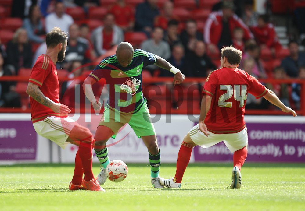Danny Fox (L) and David Vaughan (R) of Nottingham Forest in action against Andre Ayew of Swansea City<br /> <br />  - Mandatory by-line: Jack Phillips/JMP - 25/07/2015 - SPORT - FOOTBALL - Nottingham - The City Ground - Nottingham Forest v Swansea - Pre-Season Friendly