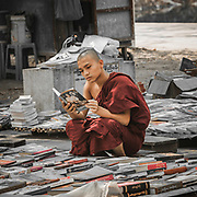 Buddhist monk at a street bookshop in Mandalay, Myanmar
