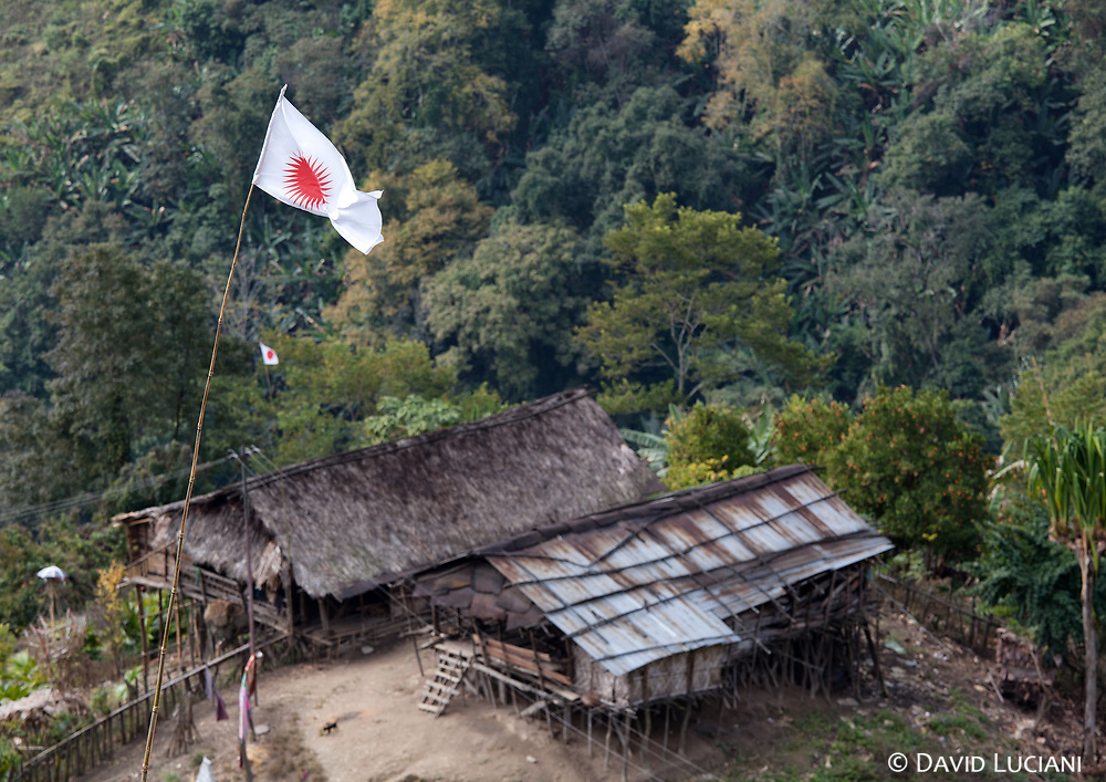 A Donyi Polo flag near a Hill Miri (Nyishi) settlement, seen on the way leading to Daporijo. The Nyishi are the largest tribe in Arunachal Pradesh. Nyishi warriors were known to be much more aggressive than other tribes. In past history when Apatani settlements were attacked by the Nyishi, the most beautiful Apatani women were kidnapped by their warriors.