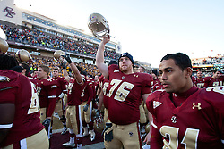 November 20, 2010; Chestnut Hill, MA, USA;  Boston College Eagles offensive linesman Bobby Vardaro (76) celebrates with teammates after the game against the Virginia Cavaliers at Alumni Stadium.  Boston College defeated Virginia 17-13.