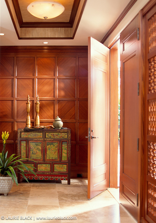Traditional Hawaii foyer with warm wood and antiques.