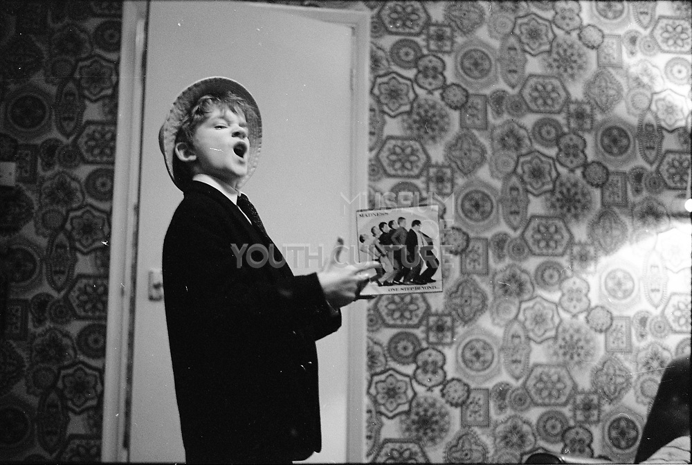 Neville in Front Room With Madness single, Hawthorne Road, High Wycombe, UK. 1980s.
