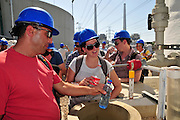 Desalination plant. Visitors taste desalinated water. This facility turns salt water into drinking water using the Reverse Osmosis Process and will produce 127 million cubic metres of fresh water each year. Photographed in Hadera, Israel.