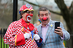 © Licensed to London News Pictures. 02/02/2020. London, UK. Clowns take a selfie as they arrive to attend a service at All Saints Church in East London in memory of Joseph Grimaldi (1778-1837), an English actor, comedian and dancer, who is widely considered to be the 'Father' of modern clowning. Photo credit: Dinendra Haria/LNP