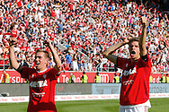 Philipp Lahm (left) and Thomas Mueller of Bayern Munich celebrate winning the Bundesliga title at Audi Sportpark, Ingolstadt<br /> Picture by EXPA Pictures/Focus Images Ltd 07814482222<br /> 07/05/2016<br /> ***UK &amp; IRELAND ONLY***<br /> EXPA-EIB-160507-0057.jpg