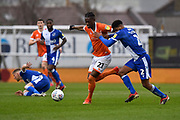 Armand Gnanduillet (21) of Blackpool battles for possession with Mark Little (2) of Bristol Rovers during the EFL Sky Bet League 1 match between Bristol Rovers and Blackpool at the Memorial Stadium, Bristol, England on 15 February 2020.