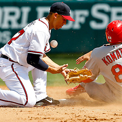 March 19, 2012; Lake Buena Vista, FL, USA; Atlanta Braves shortstop Andrelton Simmons (67) loses the ball as he applies the tag to St. Louis Cardinals right fielder Erik Komatsu (82) on a stolen base during the top of the sixth inning of a spring training game at Disney Wide World of Sports complex. Mandatory Credit: Derick E. Hingle-US PRESSWIRE