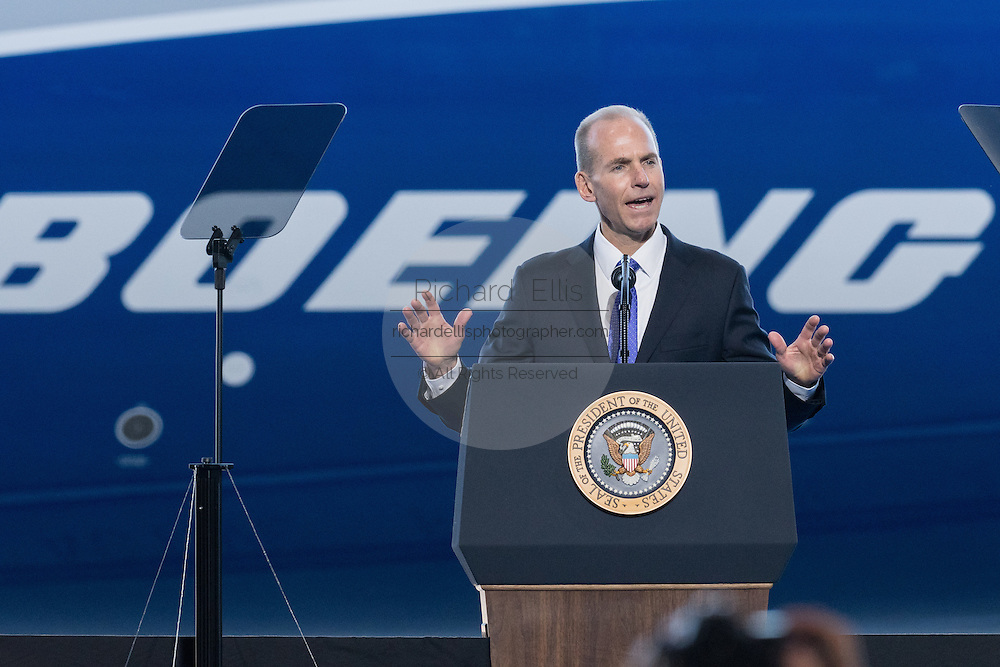 Boeing CEO Dennis Muilenburg introduces U.S. President Donald Trump during the rollout ceremony for the new Boeing 787-10 Dreamliner aircraft at the Boeing factory February 17, 2016 in North Charleston, SC. President Donald Trump was the keynote speaker at the event.