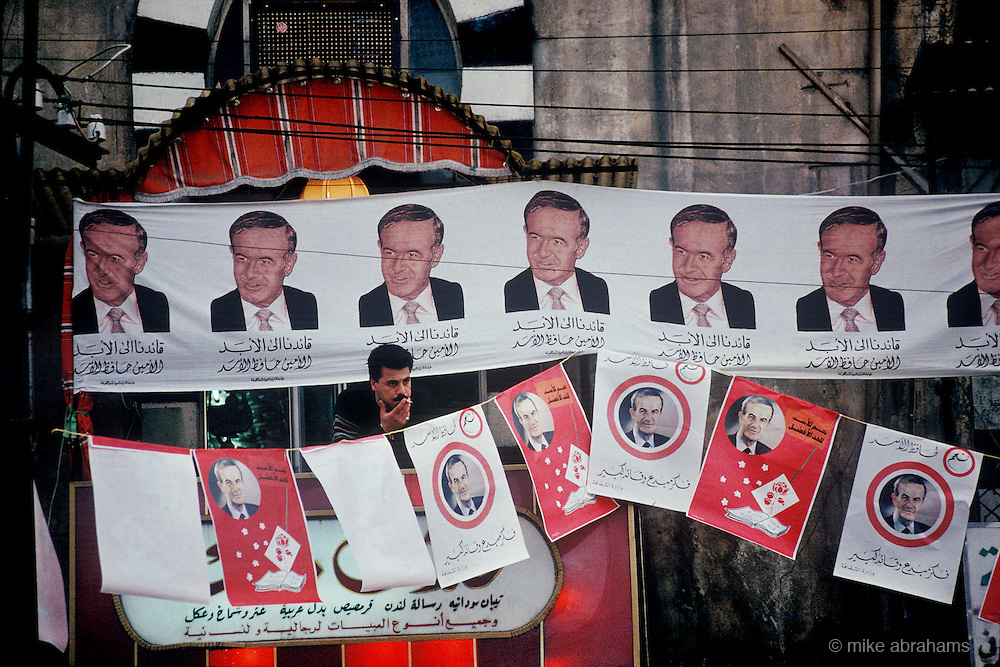 The Cult of Assad. Propaganda and posters supporting President Hafez al-Assad during the referendum on his rule. Syria 1991