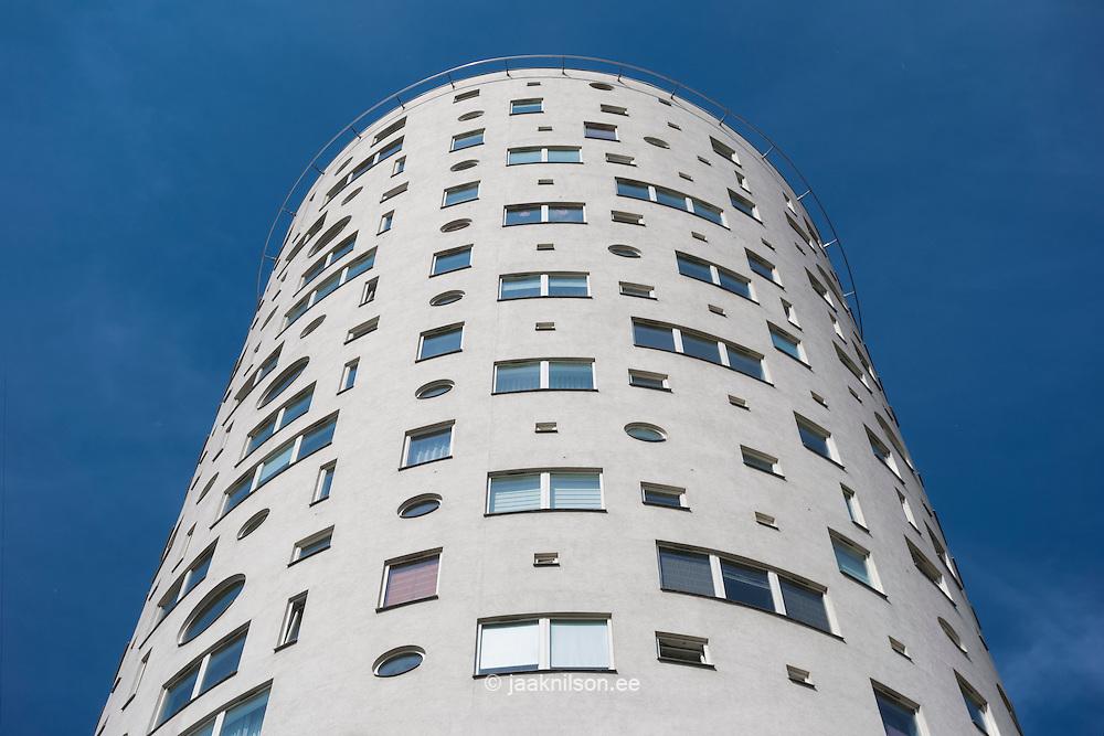 Modern round apartment building skyscraper Tigutorn in Tartu, Estonia. Round facade with windows.