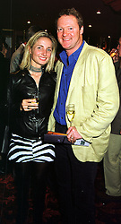 MR & MRS RORY BREMNER he is the comedian, at a party in London on 12th October 1999.MXM 30