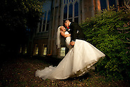 Groom dips bride in front of the San Antonio church after ceremony.