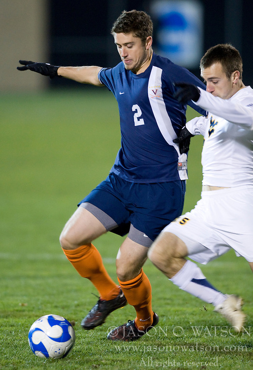 Virginia midfielder/defender Chris Tierney (2) fends off West Virginia midfielder Mike Anoia (15).  The West Virginia Mountaineers defeated the Virginia Cavaliers 1-0 in the second round of the 2007 NCAA Men's Soccer Tournament at Dick Dlesk Stadium in Morgantown, WV on November 28, 2007.