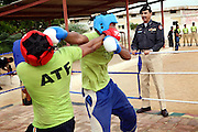 Colonel Abdul Wahid Khan (right) is inciting young recruits during a boxing class at the Shaheed Benazir Bhutto Elite Police Training Center, a commando and anti-terrorism academy on the outskirts of Karachi, are exercising and simulating extreme actions on a high tower located on the premises. The training center was founded by retired colonel Abdul Wahid Khan, a brave officer who served as a gunship helicopter pilot in the Pakistani Air Force and around the globe with the United Nations, but who's first task as a young army officer in 1979 was to train Afghan Mujahedeen to fight the Soviet Army, the very Mujahedeen that are today's Taleban.