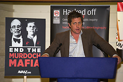 © Licensed to London News Pictures. 17/05/2012. London, UK.  Actor Hugh Grant speaking at a rally for media reform organised by Hacked Off and the Co-ordinating Centre for Media Reform at Central Hall, Westminster, London on May 17, 2012. Photo credit : Ben Cawthra/LNP