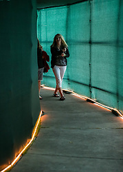 April 13, 2018 - Houston, TX, U.S. - HOUSTON, TX - APRIL 13:  Tennis fans walk through covered walkaways to the courts during the Quarterfinal round of the Men's Clay Court Championship on April 13, 2018 at River Oaks Country Club in Houston, Texas.  (Photo by Leslie Plaza Johnson/Icon Sportswire) (Credit Image: © Leslie Plaza Johnson/Icon SMI via ZUMA Press)