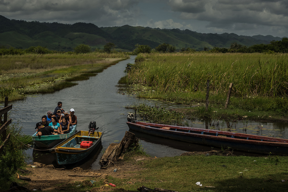 JULY 3, 2014: A boat full of undocumented migrants, including several minors being smuggled by a coyote, arrive at a ranch where they were transferred into a pick-up truck along the border between Guatemala and Mexico.  PHOTO: Meridith Kohut for The New York Times