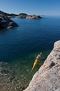 A kayaker on Lake Superior at Pukaskwa National Park in Ontario Canada