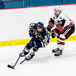 GEORGETOWN, ON - DECEMBER 12: David Gucciardi #27 of the Toronto Patriots skates with the puck under pressure from Alec Tiley #28 of the Georgetown Raiders in the second period on December 12, 2018 at Gordon Alcott Memorial Arena in Georgetown, Ontario, Canada.<br /> (Photo by Ryan McCullough / OJHL Images)