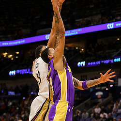 Mar 22, 2018; New Orleans, LA, USA; New Orleans Pelicans forward Anthony Davis (23) blocks a shot by Los Angeles Lakers forward Kyle Kuzma (0) during the first quarter at the Smoothie King Center. Mandatory Credit: Derick E. Hingle-USA TODAY Sports