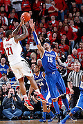 LOUISVILLE, KY - DECEMBER 29: Chane Behanan #21 of the Louisville Cardinals shoots against Willie Cauley-Stein #15 of the Kentucky Wildcats at the KFC Yum! Center in Louisville, Kentucky. Louisville won 80-77. (Photo by Joe Robbins)
