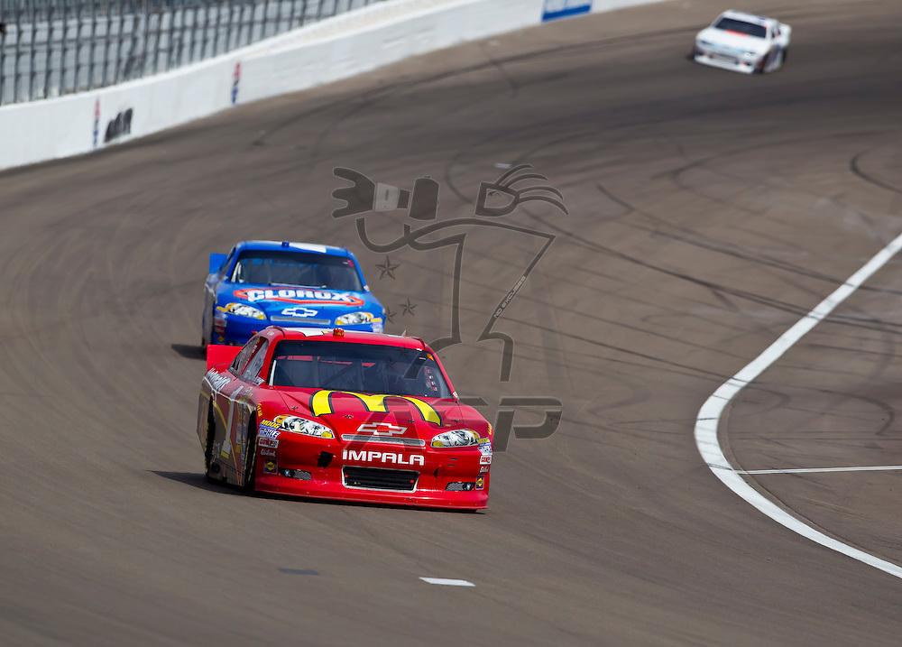 LAS VEGAS, NV - MAR 11, 2012:  Jamie McMurray (1) and Juan Pablo Montoya (42) battle for position during the Kobalt Tools 400 race at the Las Vegas Motor Speedway in Las Vegas, NV.
