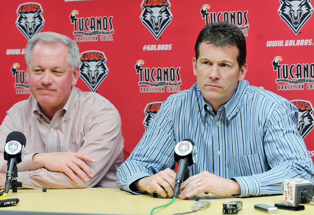 University of New Mexico head basketball coach Steve Alford, right, announces that he is leaving the Lobos to take over UCLA's basketball program, Saturday, March 30, 2013, at The Pit in Albuquerque, N.M. Sitting next to him is UNM's director of athletics Paul Krebs, left. (Marla Brose/Albuquerque Journal)
