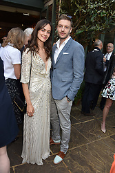 Ellen Francis Gibbons and guest at The Ivy Chelsea Garden Summer Party, Kings Road, London, England. 14 May 2018.