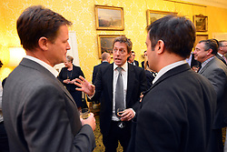 © Licensed to London News Pictures. 11/09/2013. London, UK Hugh Grant (centre) talks to Nick Clegg (L) The Deputy Prime Minister, Nick Clegg, hosts a reception at Admiralty House in Whitehall this evening, 11 September 2013, to celebrate the government's progress in equal marriage. From next year gay people will be able to get married. A number of high profile guests including openly supportive celebrities, campaigners, religious figures and charities were in attendance.<br /> The London Gay Men Chorus Ensemble performed at the event. . Photo credit : Stephen Simpson/LNP