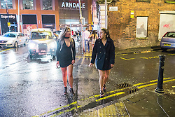 © Licensed to London News Pictures . 01/01/2017 . Manchester , UK . Two women cross Well Street , a year to the minute after another photograph that went viral , taken from the same position , was taken . People on a night out in Manchester City Centre , after midnight on January 1st 2017 . Photo credit : Joel Goodman/LNP