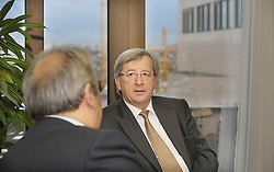 Jean-Claude Juncker, Luxembourg's prime minister, speaks with Ioannis Papathanasiou, Greece's finance minister, during a bilateral meeting at the European Council headquarters in Brussels, Belgium, on Monday, Jan. 19, 2008. (Photo / Jock Fistick).