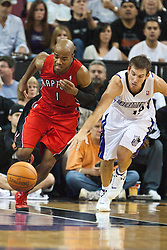 November 1, 2010; Sacramento, CA, USA;  Toronto Raptors point guard Jarrett Jack (1) and Sacramento Kings point guard Beno Udrih (19) fight for a loose ball during the third quarter at the ARCO Arena. The Kings defeated the Raptors 111-108.