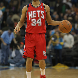 Jan 08, 2010; New Orleans, LA, USA; New Jersey Nets guard Devin Harris (34) controls the ball against the New Orleans Hornets during the first half at the New Orleans Arena. The Hornets defeated the Nets 103-99. Mandatory Credit: Derick E. Hingle-US PRESSWIRE.
