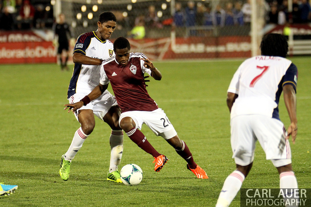 August 3rd, 2013 - Colorado Rapids forward Deshorn Brown (26) pushes the ball past Real Salt Lake midfielder Khari Stephenson (23) in the second half of action in the Major League Soccer match between Real Salt Lake and the Colorado Rapids at Dick's Sporting Goods Park in Commerce City, CO