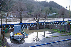 © Licensed to London News Pictures. 26/02/2020. Ironbridge, UK. A high volume water removes water as flood defences are under threat of collapse in Ironbridge on part of the River Severn, police evacuated part of the town when the flood barriers moved approximately three feet under the strain of the rising water levels. Photo credit: Peter Manning/LNP