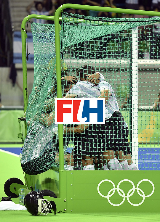 Argentina's players celebrate their fourth goal during the men's Gold medal field hockey Belgium vs Argentina match of the Rio 2016 Olympics Games at the Olympic Hockey Centre in Rio de Janeiro on August 18, 2016. / AFP / PHILIPPE LOPEZ        (Photo credit should read PHILIPPE LOPEZ/AFP/Getty Images)
