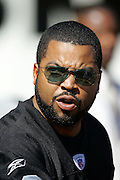 OAKLAND, CA - OCTOBER 2:  Rapper O'Shea Jackson, aka Ice Cube wears a Raiders jersey on the field during pregame at the Oakland Raiders game against the Dallas Cowboys at McAfee Coliseum in Oakland, California on October 2, 2005. The Raiders defeated the Cowboys 19-13. ©Paul Anthony Spinelli *** Local Caption *** Ice Cube
