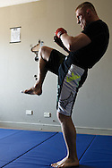 SYDNEY, AUSTRALIA, FEBRUARY 24 2011: UFC lightweight division fighter Dennis Siver warms up before a training session with coach Nico Sulenta (not pictured) ahead of his fight with George Sotiropoulos at UFC 127.