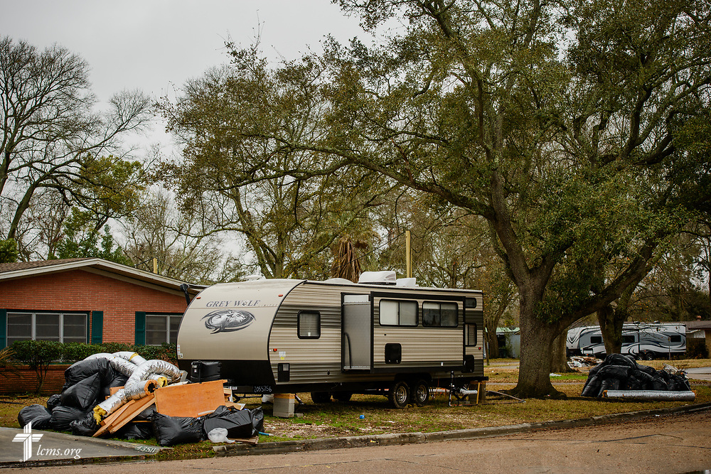 Trailers parked in front of damaged homes on Wednesday, Feb. 7, 2018, in Port Arthur, Texas. Recovery work is still underway almost six months after Hurricane Harvey devastated parts of Texas.  LCMS Communications/Erik M. Lunsford