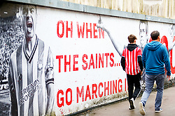 A general view of a 'Oh When The Saints.... Go Marching In' sign as fans walk through an overpass leading to St Marys Stadium prior to kick off - Mandatory by-line: Ryan Hiscott/JMP - 12/08/2018 - FOOTBALL - St Mary's Stadium - Southampton, England - Southampton v Burnley - Premier League