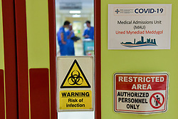 Signage on the Covid-19 ward at the Neath Port Talbot Hospital, in Wales, as the health services continue their response to the coronavirus outbreak.