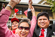 "10 DECEMBER 2012 - BANGKOK, THAILAND: Red Shirt leaders clasp hands in front the Thai Government House in Bangkok Monday. The Thai government announced on Monday, which is Constitution Day in Thailand, that will speed up its campaign to write a new charter. December 10 marks passage of the first permanent constitution in 1932 and Thailand's transition from an absolute monarchy to a constitutional monarchy. Several thousand ""Red Shirts,"" supporters of ousted and exiled Prime Minister Thaksin Shinawatra, motorcaded through the city, stopping at government offices and the offices of the Pheu Thai ruling party to present demands for a new charter.         PHOTO BY JACK KURTZ"